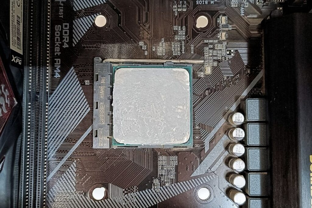 old thermal paste residue on a CPU